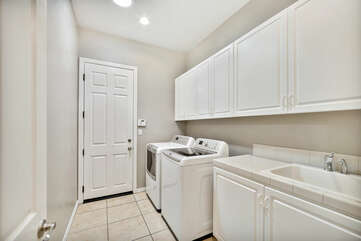 Laundry room features a sink to help keep your clothes clean. Tide Pods provided to travel home with clean clothes!