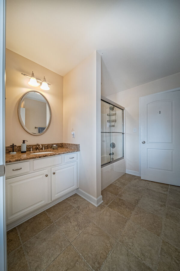 Bathroom with wall mirror and tub/shower combo
