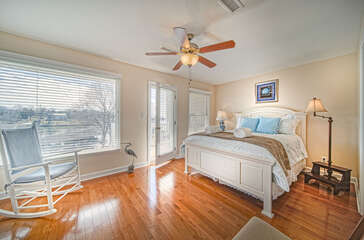 Master Bedroom with ceiling fan and balcony overlooking the lake