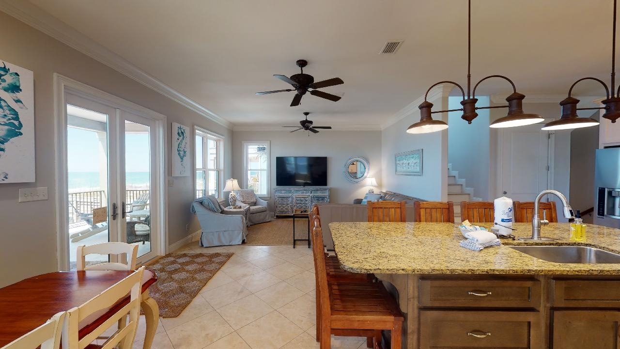 Dining Set, Living Area, TV, Ceiling Fans, Kitchen Counter, and Stools.