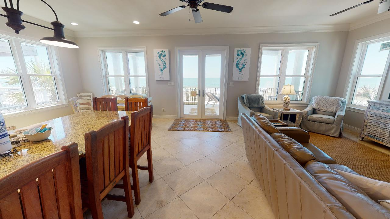 Kitchen Counter, Stools, Patio Doors, Windows, Sofa, and Arm Chairs.