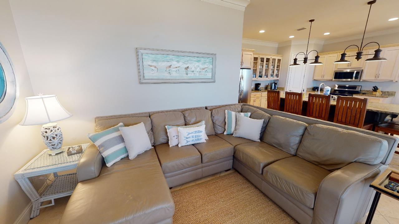 Sectional Sofa, Kitchen with Counter, High Chairs, Ceiling Lamps, and Side Tables.