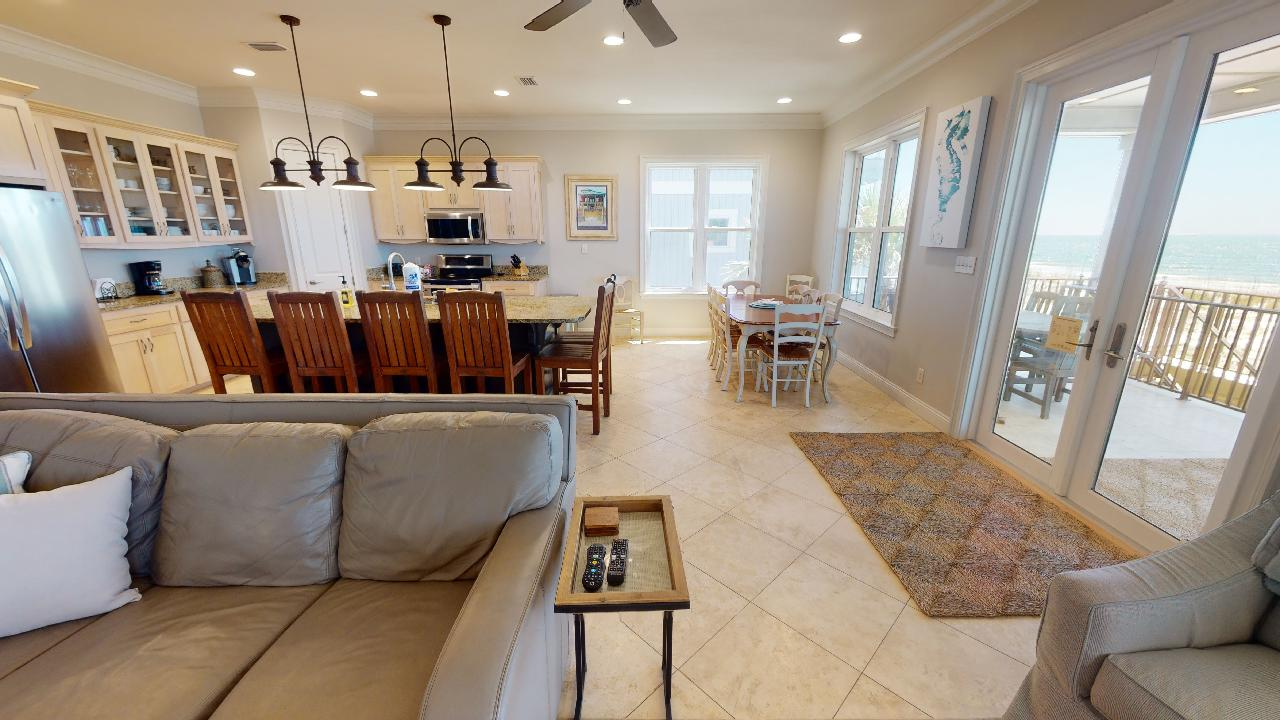 Sofa, Table, Dining Set, Kitchen Counter, Stools, Patio Doors, and Windows.