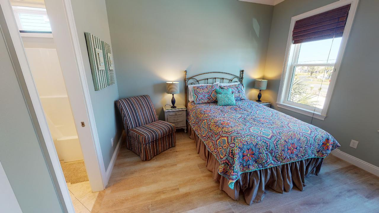 Large Bed, Window, Arm Chair, Table Lamps, and Nightstands.