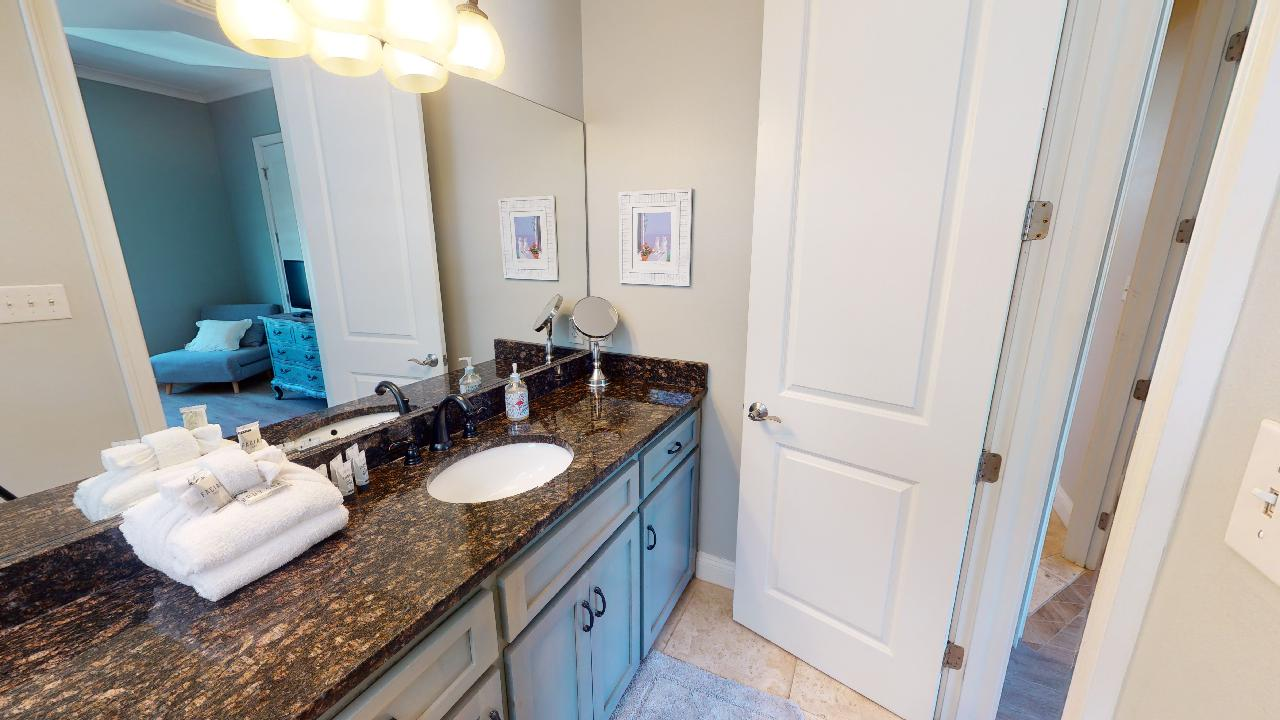 Single Vanity Sink, Mirror, and Wall Lamp.