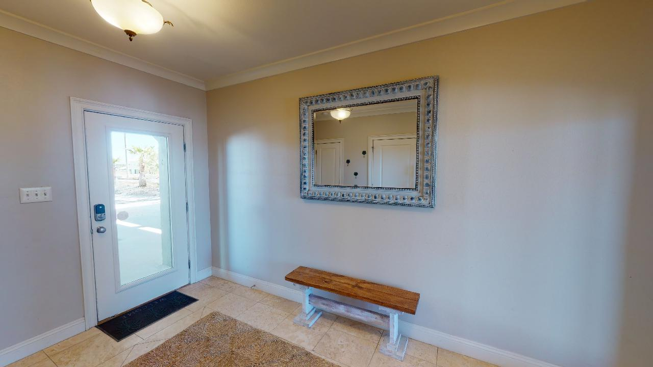 Entrance Door Area with Bench and Mirror.