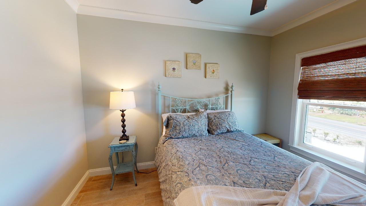 Large Bed, Nighstand, Table Lamp, and Window.