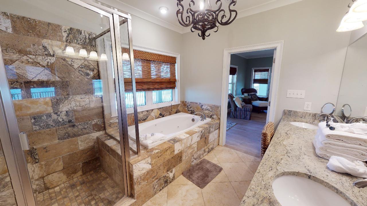 Walk-In Shower, Bathtub, Mirror, Lamps, and Double Sink Vanity.