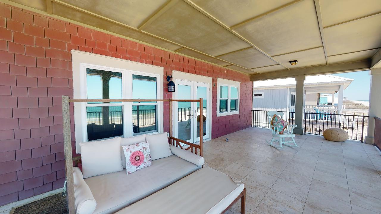The Balcony of the Master Bedroom with Outdoor Seating Set and Rocking Chair.