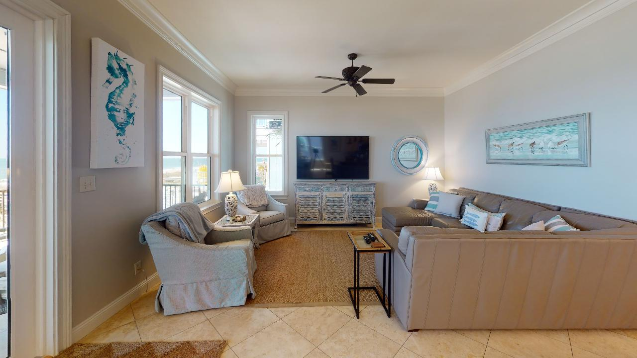 Arm Chairs, Side Tables, Sectional Sofa, TV, Ceiling Fan, and Windows.