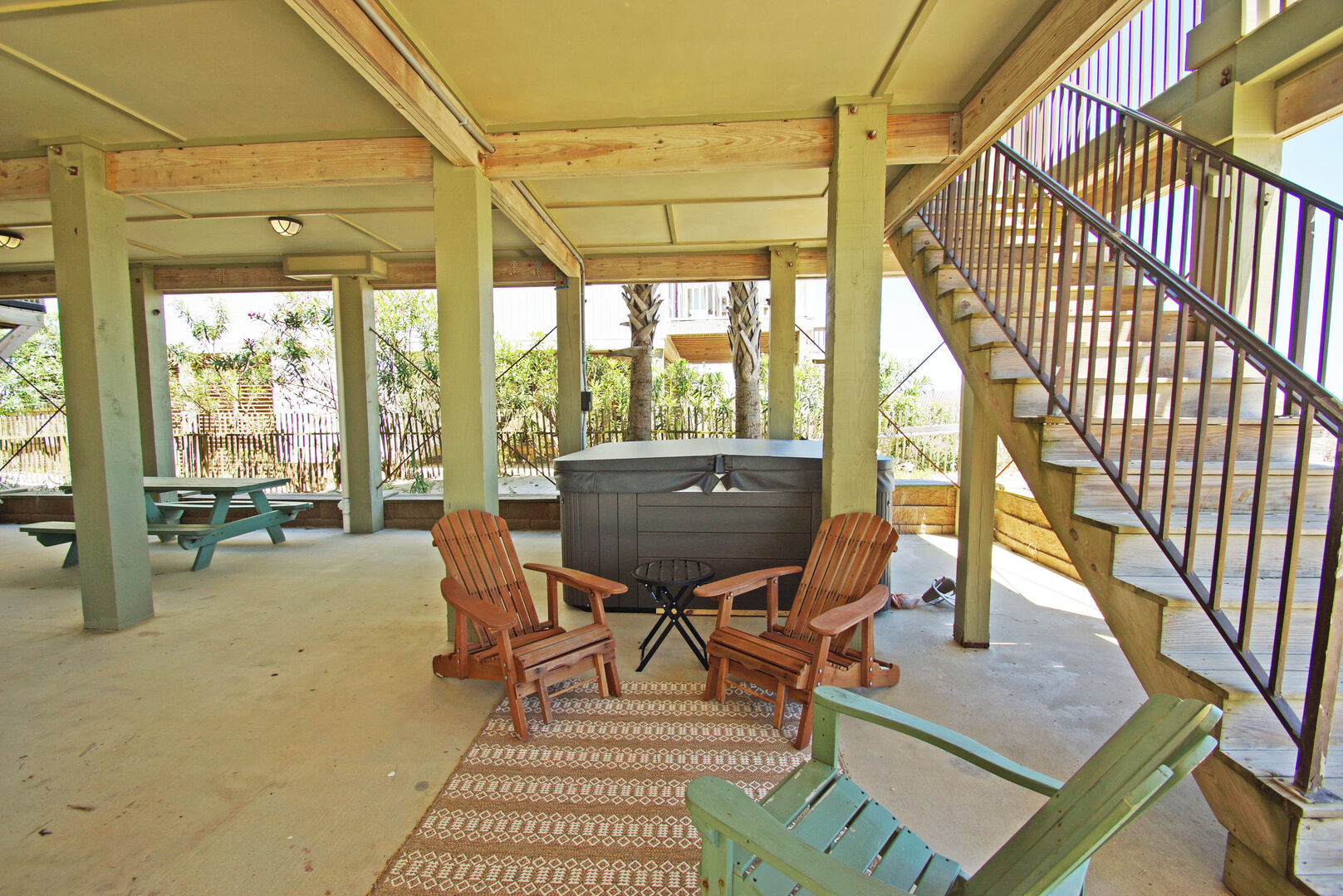 Hot Tub and Outdoor Chairs in the Shaded Area Under the House.