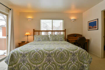 Master Bedroom with Green Floral Comforter