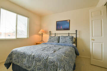 Second Bedroom with Blue Floral Comforter on the Bed