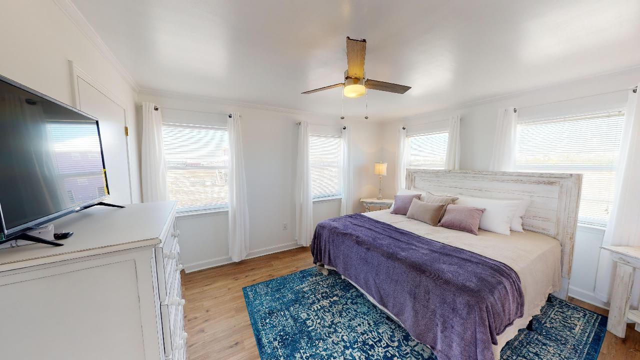 King sized bed and television in bedroom 2