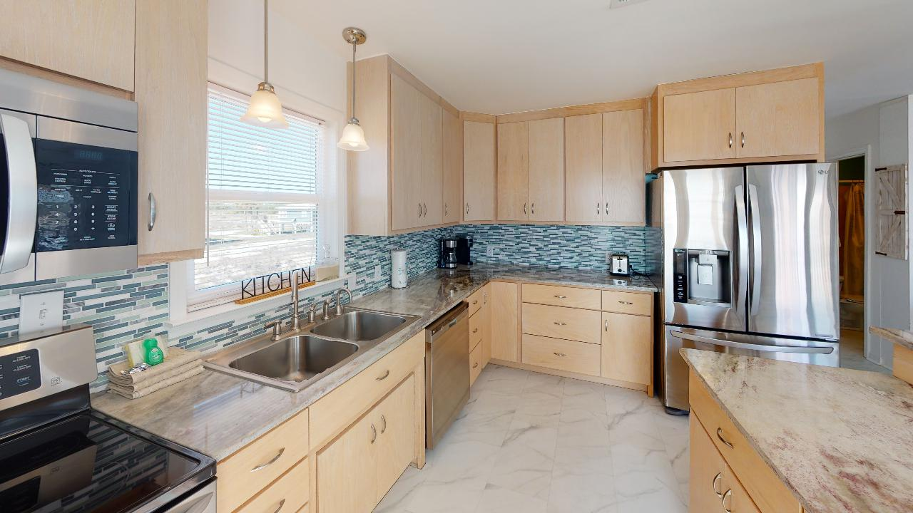 Brand new kitchen with oven and refrigerator