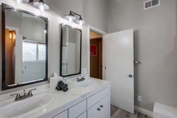 Double Sink Vanity, Wall Lamps, and Mirrors.