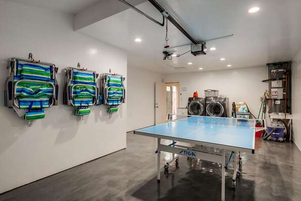 Garage with Beach Equipment, Ping Pong Table, Washer, and Dryer.