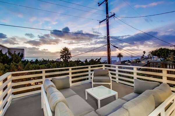Ocean View Balcony with Outdoor Seating Set.