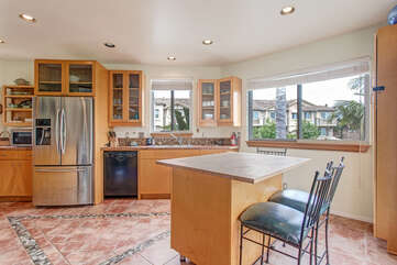 Breakfast for two? The kitchen offers a lot of natural light from the surrounding windows.