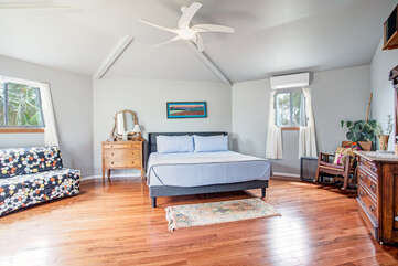 Master bedroom and queen futon. This extra large room offers plenty of space to move around.