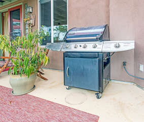 Off the living room you will find a balcony with a 4-burner gas grill.