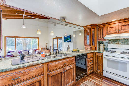 Fully Equipped Kitchen with a Large Granite Counter Island