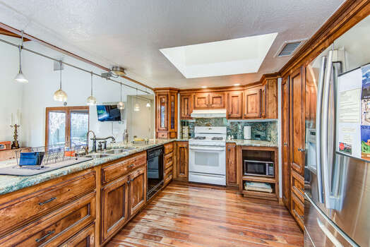 Spacious Kitchen with Stunning Cabinetry and Granite Counters