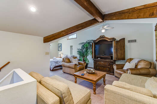 Loft Sitting Area with Comfortable Furnishings and a 50