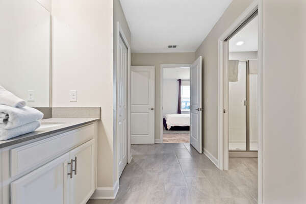Connects to a walk in shower which has a sliding door for privacy