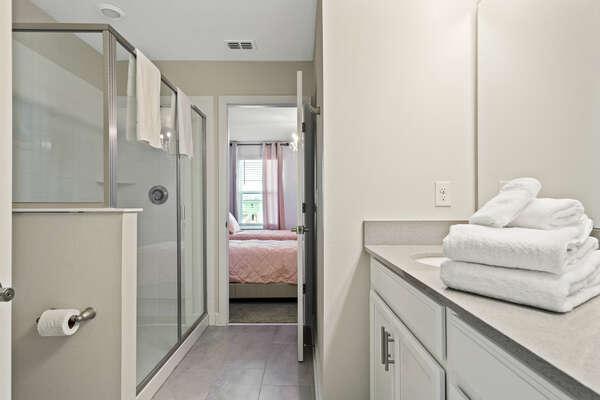 Shared Jack & Jill bathroom with a kid's bedroom