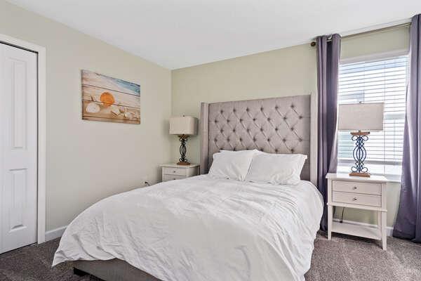 Get a good night's sleep in this queen bedroom