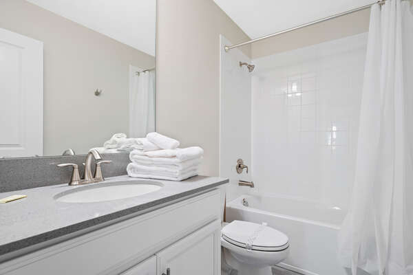 Bathroom with a shower & tub combo