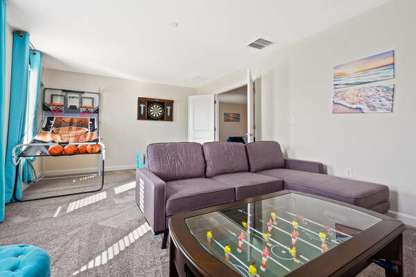 The coffee table doubles as a foosball table