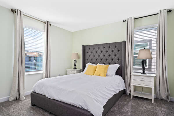 Retreat to this queen bedroom after a fun day
