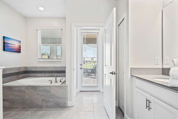 The ensuite bathroom has private access to the pool area