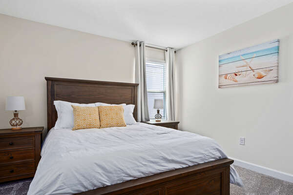 Queen bed with beach accents