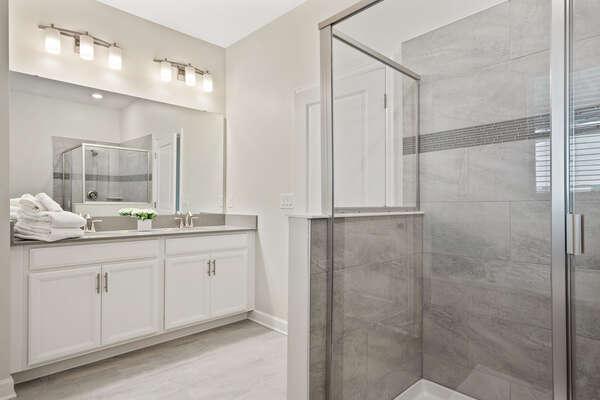 Walk-in shower and dual vanity