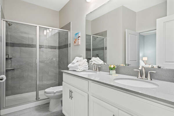 The ensuite has a dual vanity and walk-in shower
