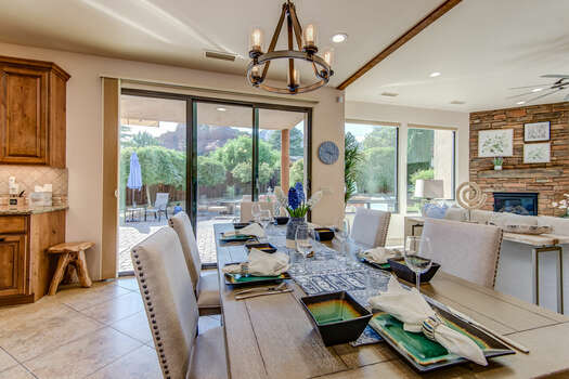 Dining Area with a Wood Table and Seating for Six and Patio Access