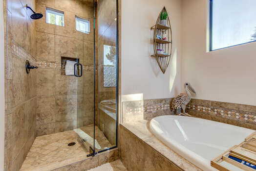 Master Bath with a Large Soaking Tub and a Marble Tile Shower