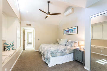 The master bedroom with large flat screen Smart TV
