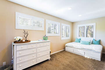 The master bedroom also has a full-size daybed, tucked away in a little nook of the bedroom.