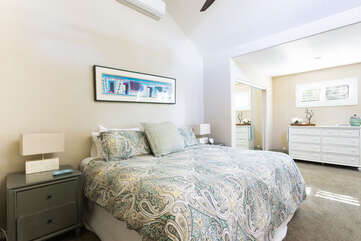 The master bedroom offer vaulted ceilings and a king bed.