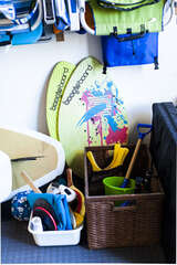 Skimboards, boogie boards, 2 paddle boards, and other beach items.