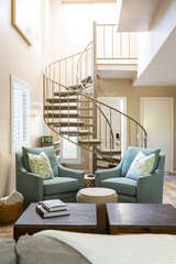 The winding staircase leads to the 2nd floor where the 2 bedrooms and 2 full bathrooms are located