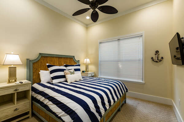 Downstairs nautical bedroom with a King bed