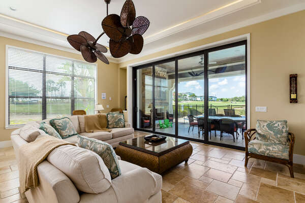 Slide open the large glass doors to access the private patio
