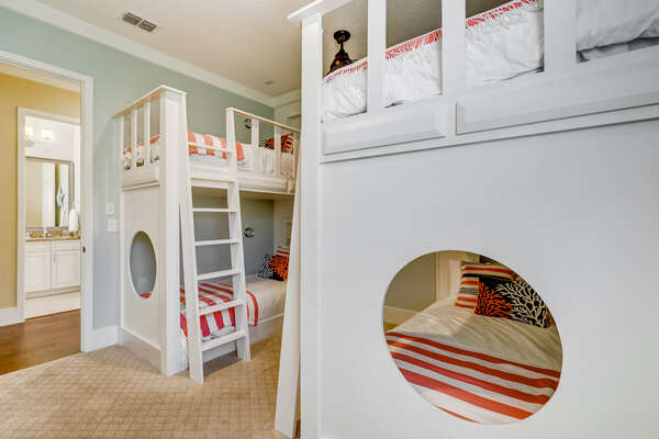 Fun kids bedroom with two sets of twin over twin bunk beds