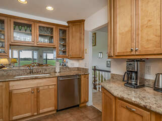 Granite counter tops with lots of cabinet storage space.