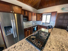 Five burner gas cook top and stainless steel appliances